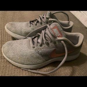 Grey Nike running shoe